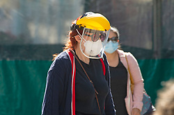 ©Licensed to London News Pictures 24/09/2020  <br /> Bromley, UK. This lady is wearing a yellow face shield a mask and protective gloves. Shoppers in Bromley High Street, Bromley, South East London wearing protective  masks today to help protect themselves and others  from the threat of Coronavirus. Photo credit:Grant Falvey/LNP
