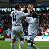 Kevin Davies celebrates scoring 1st goal with Jay Jay Okocha<br /> Bolton Wanderers 2004/05<br /> Bolton Wanderers v Liverpool 29/08/04<br /> The Premier League<br /> Photo Robin Parker Fotosports International<br /> NORWAY ONLY