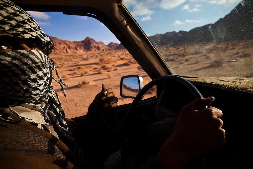 Bedouin guide Etzal Salem drives across the desert in a jeep in Wadi Rum, Jordan.