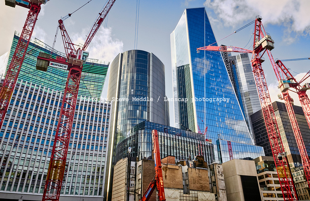 Construction work in Fenchurch Street showing Fen Court building, Willis building and Scalpel building,  London, England - 18 February 2021