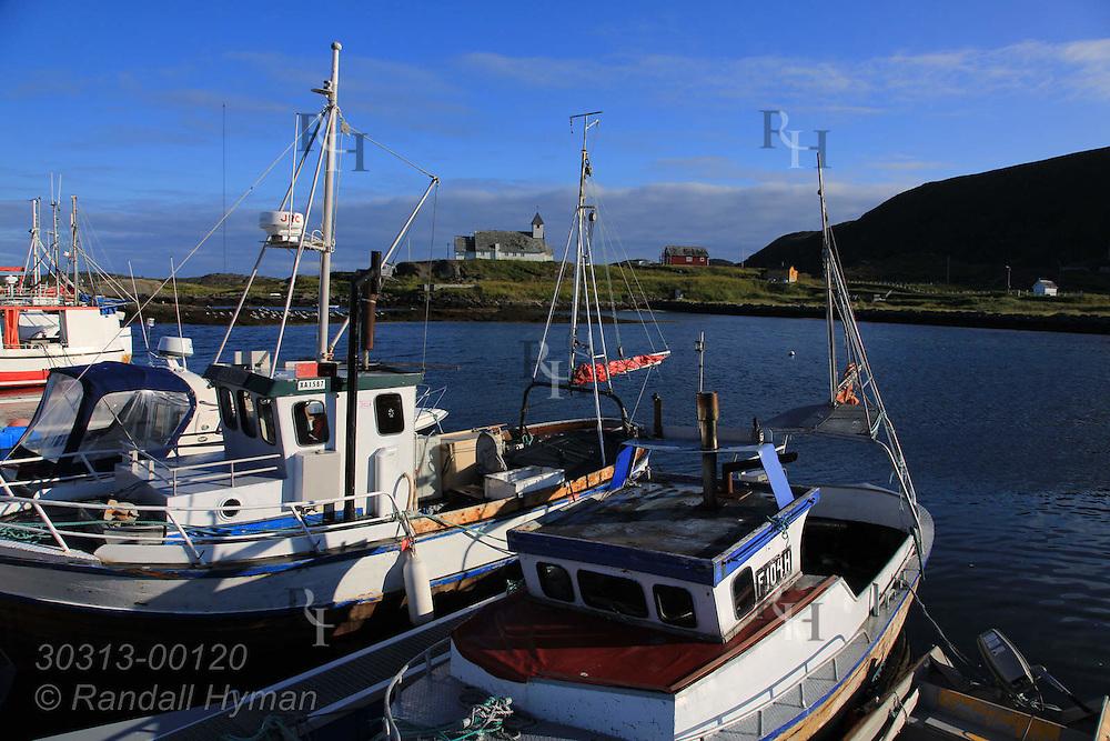 Boat masts frame church in town of Ingoy on Ingoya island, Finnmark, Norway.