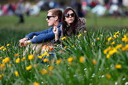 © Licensed to London News Pictures. 05/04/2016. London, UK. People enjoying sunshine and warm weather in St James's Park, London on Tuesday, 5 April 2016. Photo credit: Tolga Akmen/LNP