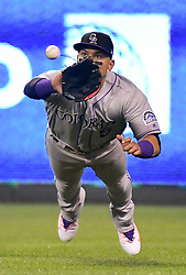 August 22, 2017 - Kansas City, MO, USA - Colorado Rockies right fielder Carlos Gonzalez dives for an out on the Kansas City Royals' Whit Merrifield to end the seventh inning at Kauffman Stadium in Kansas City, Mo., on Tuesday, Aug. 22. 2017. (Credit Image: © John Sleezer/TNS via ZUMA Wire)