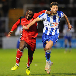 TELFORD COPYRIGHT MIKE SHERIDAN 12/1/2019 - Dan Udoh of AFC Telford and Myles Anderson during the Vanarama Conference North fixture between AFC Telford United and Hartlepool United at the Super Six Stadium.