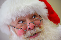 Santa Claus aka Santa Chester, (as portrayed by Chester Davis of Manalapan), paid a visit to The Jordan Real Estate Group in Ocean Twp. on Thursday, December 18, 2014. This was one of the stops on a decorations judging tour, a fundraiser to benefit The Believe Project which helps seriously ill children.  (Russ DeSantis   For Inside Jersey) / Ed. Note: Photos are for Inside Jersey only.