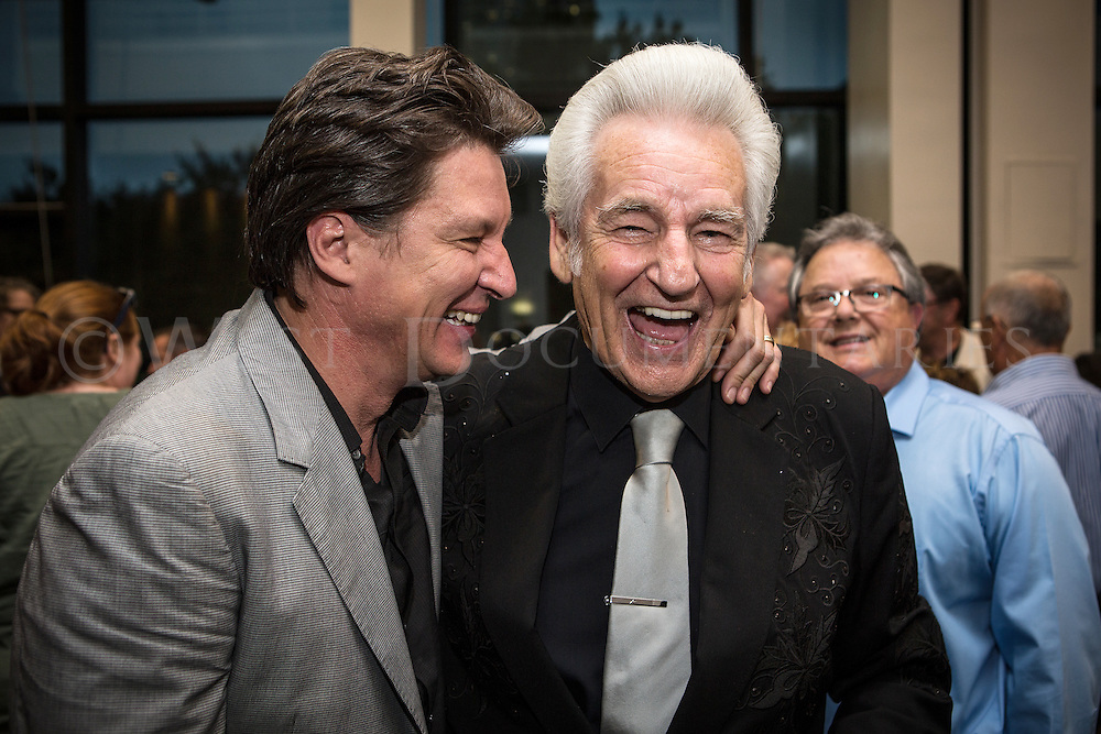Picture left to right are Ronnie Bowman and Legendary Grammy Award Winning Bluegrass artist, Del McCoury, sharing a laugh before the start of the International Bluegrass Music Awards (IBMA) on Oct. 1, 2015.