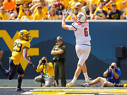 Sep 14, 2019; Morgantown, WV, USA; North Carolina State Wolfpack tight end Cary Angeline (6) catches a touchdown pass during the second quarter against the West Virginia Mountaineers at Mountaineer Field at Milan Puskar Stadium. Mandatory Credit: Ben Queen-USA TODAY Sports