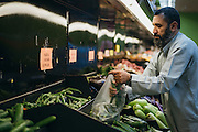 Gulab buys vegetables at the grocery store in Arlington, Texas on May 6, 2016. With respect to his religion, Gulab travels over 30 minutes to the closest store that caters to the muslim population