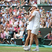 LONDON, ENGLAND - JULY 16:  Jamie Murray of Great Britain and Martina Hingis of Switzerland celebrate victory over Henri Kontinen of Finland and Heather Watson of Great Britain in the Mixed Doubles Final on Center Court during the Wimbledon Lawn Tennis Championships at the All England Lawn Tennis and Croquet Club at Wimbledon on July 16, 2017 in London, England. (Photo by Tim Clayton/Corbis via Getty Images)
