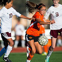 092613       Brian Leddy<br /> Gallup Bengal Amy Mascerenas (2) keeps the ball away from Rehoboth Lynx Hannah Lindsey (9) and Sierra Tahy (10) during Thursday's game at Rehoboth.