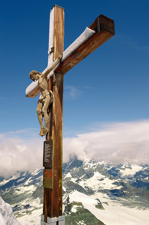 Crucifix on the peak of The little Matterhorn , Zermatt , .<br /> <br /> Visit our SWITZERLAND  & ALPS PHOTO COLLECTIONS for more  photos  to browse of  download or buy as prints https://funkystock.photoshelter.com/gallery-collection/Pictures-Images-of-Switzerland-Photos-of-Swiss-Alps-Landmark-Sites/C0000DPgRJMSrQ3U