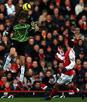 Photo: Javier Garcia/Back Page Images<br />Arsenal v Fulham, FA Barclays Premiership, Highbury, 26/12/04<br />Edwin Van Der Sar clears with his head from Robin Van Persie