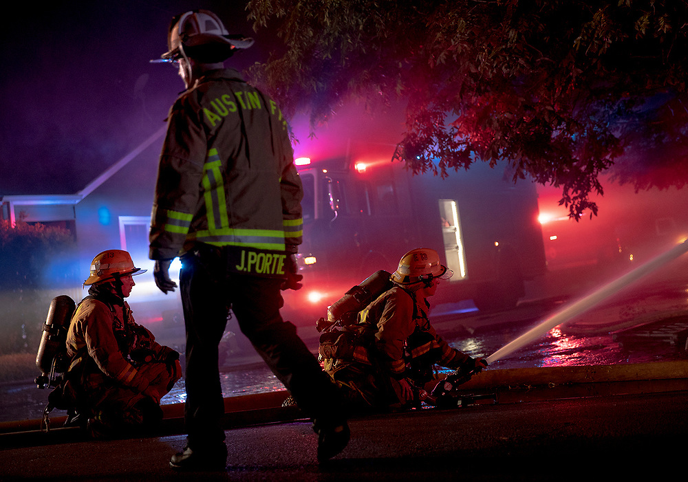 Austin firefighters battle a house fire along Red River Street just north of 45th Street on Saturday, July 20, 2019, in Austin, Texas. NICK WAGNER / AMERICAN-STATESMAN
