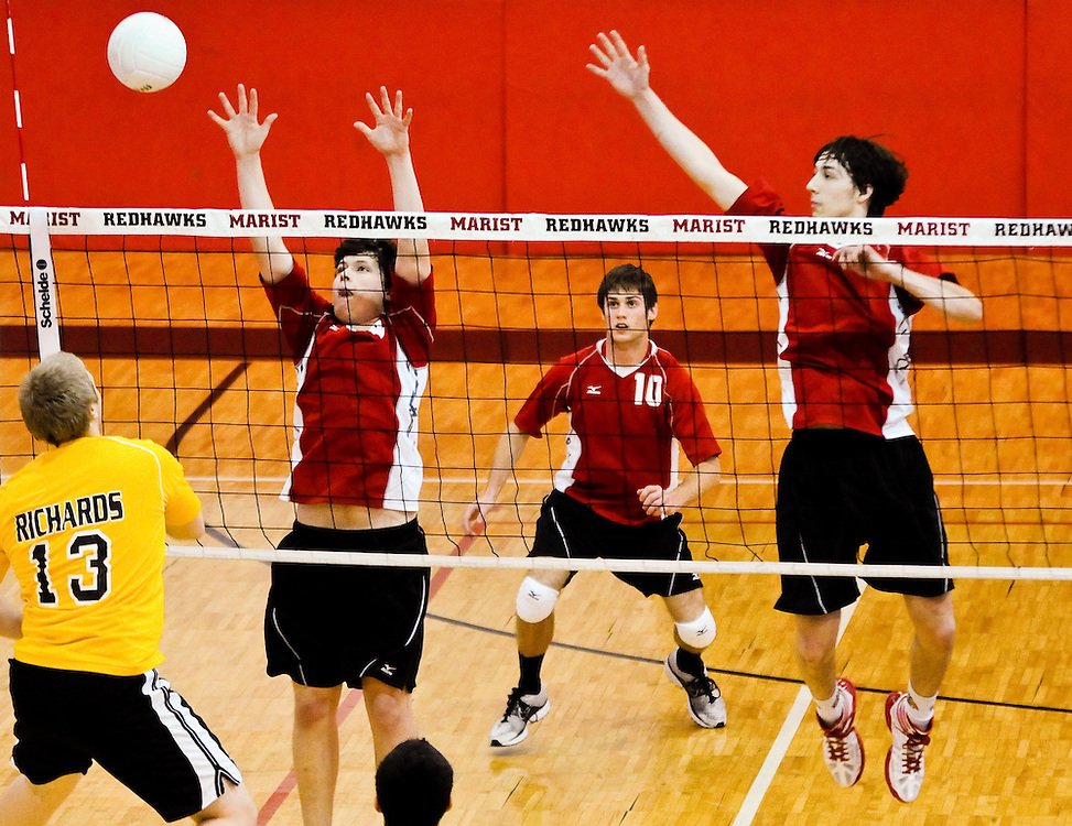 Marist High School juniors Michael Schreiber (L to R), Craig Rosner and senior Tony Natalino defend their turf from a Richards Bulldogs attack as Marist hosts the 9th Annual RedHawk Boys Volleyball Varsity Invitational Bracket Play. March 24, 2012 l Brian J. Morowczynski~ViaPhotos..For use in a single edition of Catholic New World Publications, Archdiocese of Chicago. Further use and/or distribution may be negotiated separately. ..Contact ViaPhotos at 708-602-0449 or email brian@viaphotos.com.