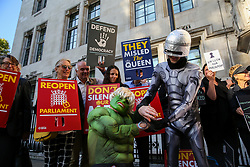 © Licensed to London News Pictures. 17/09/2019. London, UK. Protesters wearing superhero costumes demonstrate outside UK Supreme Court in London as the court begins a three day appeal hearing in the multiple legal challenges against the Prime Minister Boris Johnson's decision to prorogue Parliament ahead of a Queen's speech on 14 October. Eleven instead of the usual nine Supreme Court justices will hear the politically charged claim that Boris Johnson acted unlawfully in advising the Queen to suspend parliament for five weeks in order to stifle debate over the Brexit crisis. It is the first time the Supreme Court has been summoned for an emergency hearing outside legal term time. Lady Hale, the first female president of the court who retires next January, will preside. Photo credit: Dinendra Haria/LNP