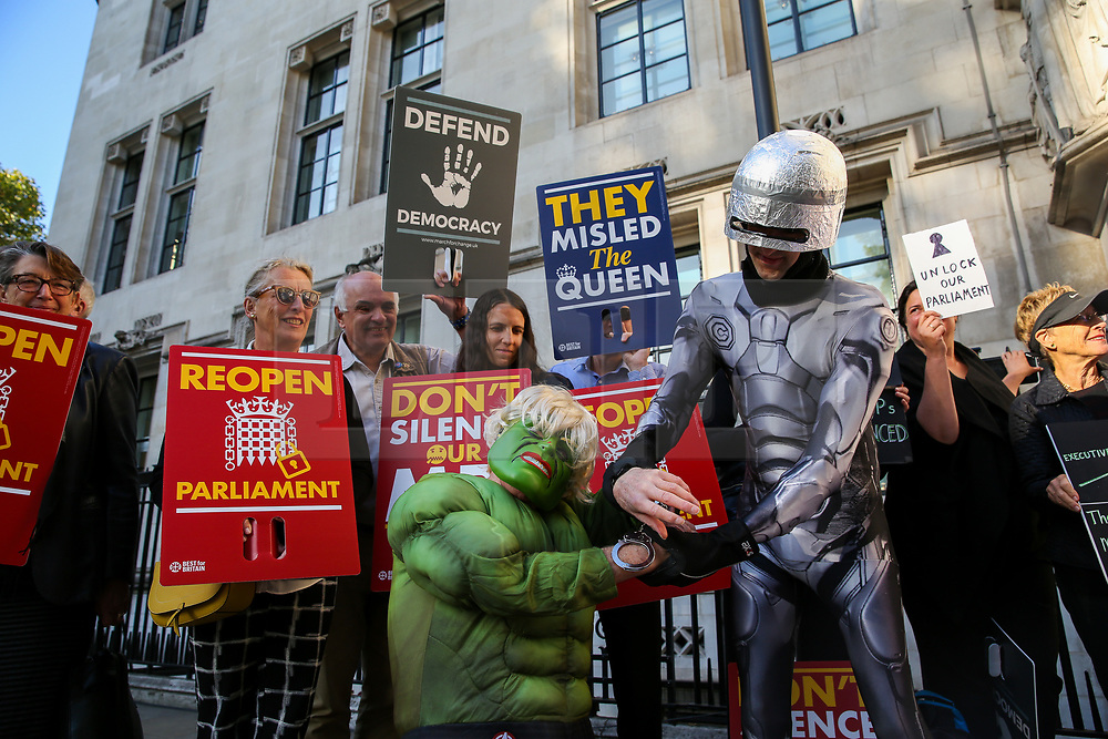 © Licensed to London News Pictures. 17/09/2019. London, UK. Protesters wearing superhero costumes demonstrate outside UK Supreme Court in London as the court begins a three day appeal hearing in the multiple legal challenges against the Prime Minister Boris Johnson's decision to prorogue Parliament ahead of a Queen's speech on 14 October. Eleven instead of the usual nine Supreme Court justices will hear the politically charged claim that Boris Johnson acted unlawfully in advising the Queen to suspend parliament for five weeks in order to stifle debate over the Brexit crisis.It is the first time the Supreme Court has been summoned for an emergency hearing outside legal term time.Lady Hale, the first female president of the court who retires next January, will preside. Photo credit: Dinendra Haria/LNP