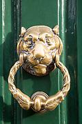 Brass face head lion door knocker, Devizes, Wiltshire, England, UK