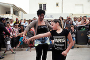 """French and Spanish Gitans play music and dance near the church<br /><br />""""Le Pelerinage des Gitans""""; the French gypsy pilgrimage of Saintes Maries de la Mer, Camargue, France<br /><br />Sainte Sara is an uncannonized saint, who legend says looked after the Christian Saints Marie Jacobe and Marie Salome, cousins of Mary Magdalene, who arrived, it is said, on the shores of the Camargue in a rudderless boat. Saint Sara is the patron saint of gypsies who come from far and wide to see her. There are even paintings of Sara as 'Kali' the black saint in Eastern Europe. Sara may have been the priestess of 'Ra' the sun-god or even servant girl to the Christian saints. No-one really knows.<br /><br />For a few weeks of the year, Roma, Gitan and Manouche gypsies come from all over Europe in May, camping in caravans around Saintes Maries de la Mer. It is a festive time where they play music, dance, party and christen their children. They all go to see Saint Sara in the crypt, kissing or touching her forehead. Many put robes on her shoulders, making her fat for the procession. In the main Gypsy procession of the 24th May, Saint Sara is allowed to leave her crypt, beneath the church, and is carried from the church to the shores of the mediterranean and back again. One day a year she is free from her prison. Hundred's of years ago the Gypsies used not even to be allowed into the church, only into the crypt like Sara...<br /><br />Roma gypsies still suffer oppressive prejudice and racism and are one of the ethnic groups the most persecuted and marginalised across Europe. The festival is one of the times where they celebrate with people of all races, their faith and traditions"""