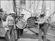 "9904-B08C. ""Loading copper & brass scrap on Fr. M. S. Washington. September 7, 1951"" (no story in newspaper)"
