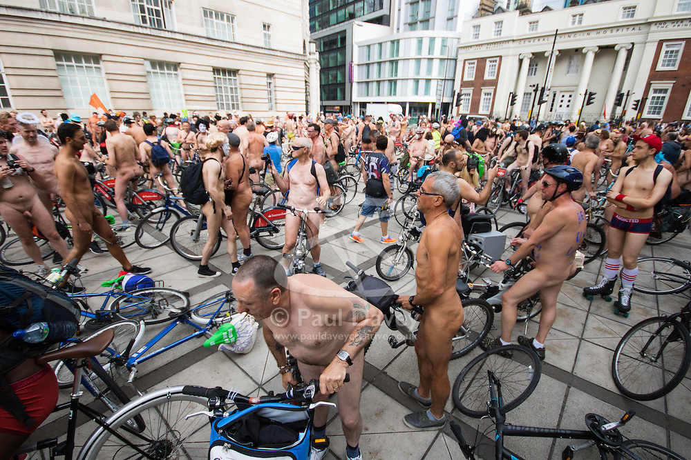 Westminster Bridge, London, June 11th 2016. Hundreds of naked and semi-naked cyclists participate in the World Naked Bike Ride that takes place in cities around the world, to highlight the alternatives to hydrocarbon fuels. PICTURED: Cyclists take a break after crossing Westminster Bridge.