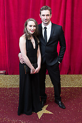 © Licensed to London News Pictures . 16/05/2015 .  The Palace Hotel , Manchester , UK . Oliver Farnworth (r) with his girlfriend . The red carpet at the 2015 British Soap Awards , The Palace Hotel , Oxford Road , Manchester . Photo credit : Joel Goodman/LNP