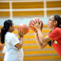 071013  Adron Gardner/Independent<br /> <br /> Payton James, 12, right, holds a shooters form at the Scout basketball camp in Fort Defiance Wednesday.