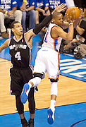 June 2, 2012; Oklahoma City, OK, USA; San Antonio Spurs guard Danny Green (4) applies pressure as Oklahoma City Thunder guard Russell Westbrook (0) looks to make a pass during the second half of a playoff game at Chesapeake Energy Arena.  Thunder defeated the Spurs 109-103 Mandatory Credit: Beth Hall-US PRESSWIRE