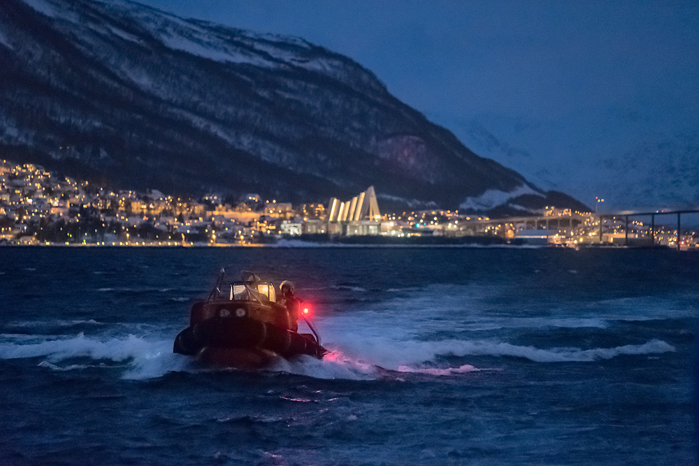 You can recognize the city of Tromsø by the Arctic Cathedral, seen in the background. It is the most famous landmark in Tromso and looks magnificent during the Christmas season when the sky is dark most of the time and the lights are always on.