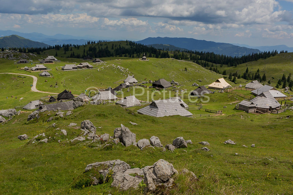 A landscape of Slovenian herders holiday mountain huts in Velika Planina, on 26th June 2018, in Velika Planina, near Kamnik, Slovenia. Velika Planina is a mountain plateau in the Kamnik–Savinja Alps - a 5.8 square kilometres area 1,500 metres 4,900 feet above sea level. Otherwise known as The Big Pasture Plateau, Velika Planina is a winter skiing destination and hiking route in summer. The herders huts became popular in the early 1930s as holiday cabins known as bajtarstvo but these were were destroyed by the Germans during WW2 and rebuilt right afterwards by Vlasto Kopac in the summer of 1945.