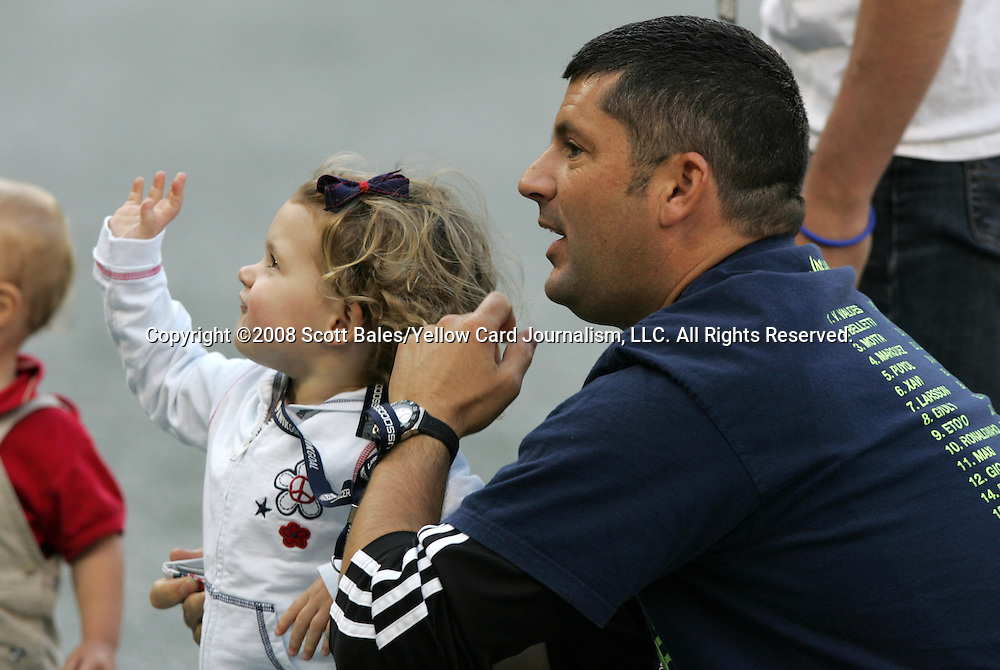 10 May 2008: United States captain Christie Rampone's (not pictured) husband Chris Rampone (r) and daugther Rylie Cate Rampone (l). The United States Women's National Team defeated the Canada Women's National Team 6-0 at RFK Stadium in Washington, DC in a women's international friendly soccer match.