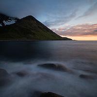 Summer midnight sun light over coast and mountain peaks, Mefjordvær, Senja, Norway