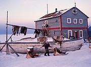 Inupiat children Sophia Ahmaogak, Lorraine Tagarook and Krystle Ahmaogak playing with homemade sleds, Ahmaogak home, Wainwright, Arctic Coast of Alaska.