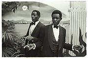 Old Etonians, Danny and Harry Matovu, nephews of the deposed President of Uganda, Godfrey Binaisa. Knebworth. 1981.