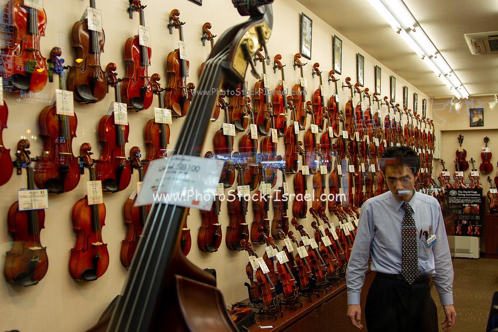 Violins on display in a musical instrument shop in Tokyo, Japan