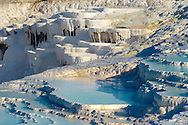 Photo  of Pamukkale Travetine Terrace, Turkey. Images of the white Calcium carbonate rock formations. Buy as stock photos or as photo art prints. 9 Pamukkale travetine terrace water cascades, composed of white Calcium carbonate rock formations, Pamukkale, Anatolia, Turkey .<br /> <br /> If you prefer to buy from our ALAMY PHOTO LIBRARY  Collection visit : https://www.alamy.com/portfolio/paul-williams-funkystock/pamukkale-hierapolis-turkey.html<br /> <br /> Visit our TURKEY PHOTO COLLECTIONS for more photos to download or buy as wall art prints https://funkystock.photoshelter.com/gallery-collection/3f-Pictures-of-Turkey-Turkey-Photos-Images-Fotos/C0000U.hJWkZxAbg