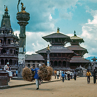 People walk among Hindu pagodas and temples in the Durbar Square in Bhaktapur, a town in the Kathmandu Valley, Nepal.