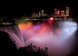 American and Bridal Veil falls at night, with Canadian side in background.
