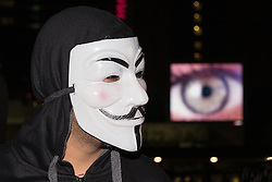 © Licensed to London News Pictures . 05/11/2015 . Manchester , UK . Protesters wearing Guy Fawkes masks at an Anonymous demonstration in Manchester , UK , this evening (5th November 2015) . Photo credit : Joel Goodman/LNP