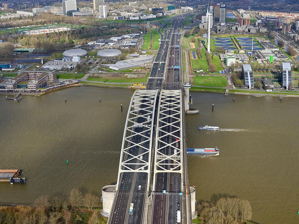 Nederland, Zuid-Holland, Rotterdam, 25-02-2020; Van Brienenoordbrug over de Nieuwe Maas. De brug bestaat uit twee boogbruggen en huisvest Rijksweg A16, richting Breda. Gezien naar Rivium, Prins Alexander, Capelle aan de IJssel.<br /> Van Brienenoord bridge over the Nieuwe Maas. The bridge consists of two arched bridges. Motorway / highway A16, direction Breda.<br /> <br /> luchtfoto (toeslag op standard tarieven);<br /> aerial photo (additional fee required)<br /> copyright © 2020 foto/photo Siebe Swart