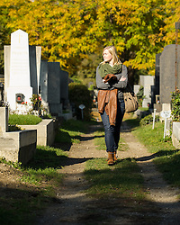 THEMENBILD - Herbst im Wiener Zentralfriedhof. Das Bild wurde am  14. Oktober 2012 aufgenommen. im Bild Frau geht zwischen Grabsteine // THEME IMAGE FEATURE - Autumn in Vienna at viennese central cemetery. The image was taken on october, 14th, 2012. Picture shows Woman between grave stones, AUT, EXPA Pictures © 2012, PhotoCredit: EXPA/ M. Gruber