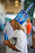"""30174108A LOUISVILLE, KY. - MAY 1, 2015: Jerry Armour of Louisville watches the monitors as a race gets underway in his makeshift bud light hat during the 141st running of the Kentucky Oaks at Churchill Downs. """"It only takes me two minutes to make it,"""" Amour said. <br /> <br /> William DeShazer for The New York Times"""