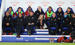 Liverpool manager Jurgen Klopp (left) and staff sit dejected on the bench during the Carabao Cup, third round match at the King Power Stadium, Leicester.