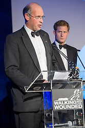 Walking With The Wounded founder Ed Parker welcomes guests as Prince Harry looks on.<br /> Prince Harry, Patron of the Walking With The Wounded South Pole Allied Challenge, attends the charity's Crystal Ball at the Grosvenor House Hotel, central London.<br /> The event hosted by Ben Fogle, with music Ellie Goulding and The Stereophonics. Also present were Olympian Matthew Pinsent CBE and Team Glenfiddich. The team of wounded service personnel will accompany the Prince on an expedition to the South Pole later this year, London,<br /> Thursday, 30th May 2013<br /> Picture by Anthony Upton / i-Images