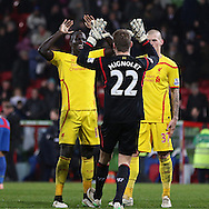 Liverpool Mamadou Sakho celebrates Liverpool's win with Liverpool Simon Mignolet during the The FA Cup 5th Round match between Crystal Palace and Liverpool at Selhurst Park, London, England on 14 February 2015. Photo by Phil Duncan.