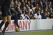 Dele Alli of Tottenham Hotspur finds himself in with the supporters as he falls over the advertising hoarding  after being pushed by Winston Reid of West Ham United. Barclays Premier league match, Tottenham Hotspur v West Ham Utd at White Hart Lane in London on Sunday 22nd November 2015.<br /> pic by John Patrick Fletcher, Andrew Orchard sports photography.