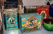 Antique tobacco and cigarette tins in Dawson City Museum, including Prince Albert in a can. Dawson City was the center of the Klondike Gold Rush (1896–99), after which population rapidly declined, in Yukon, Canada. Dawson City shrank further during World War II after the Alaska Highway bypassed it 300 miles (480 km) to the south using Whitehorse as a hub. In 1953, Whitehorse replaced Dawson City as Yukon Territory's capital. Dawson City's population dropped to 600–900 through the 1960s-1970s, but later increased as high gold prices made modern placer mining operations profitable and tourism was promoted. In Yukon, the Klondike Highway is marked as Yukon Highway 2 to Dawson City.
