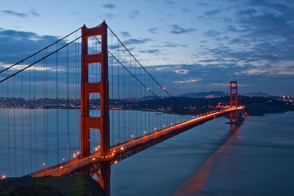 the golden gate bridge and view of san francisco at dusk from the marin headlands