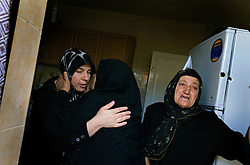 Members of the Al-Akhrass family mourn the loss of relatives who were killed in the war between Israel and Hezbollah, Aytaroun, Southern Lebanon, Oct. 23, 2006.