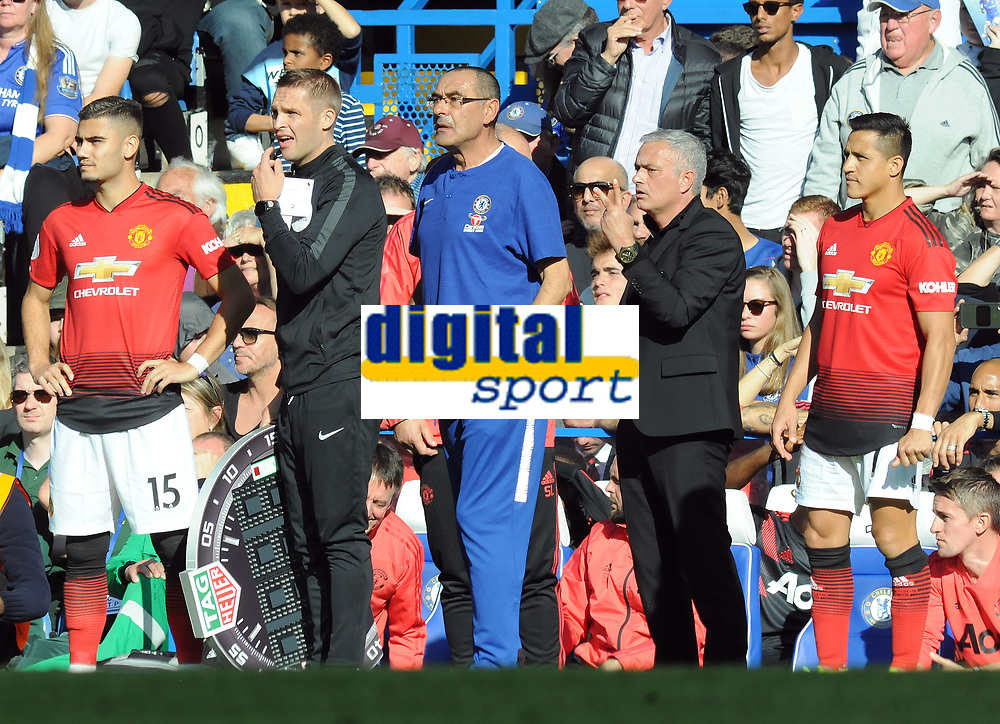 Football - 2018 / 2019 Premier League - Chelsea vs. Manchester United<br /> <br /> Confusion as Manchester United try to make two substitutions with Andreas Pereira and Alexis Sanchez waiting to come on, with Chelsea Manager, Maurizio Sarri complaining about the length of time taken, at Stamford Bridge.<br /> Jose Mourinho stands behind watching<br /> <br /> COLORSPORT/ANDREW COWIE