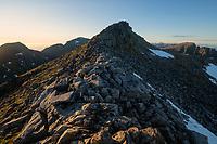 View across rocky ridge towards summit of Mengelsdalstind mountain peak, Lofotodden national park, Moskenesøy, Lofoten Islands, Norway